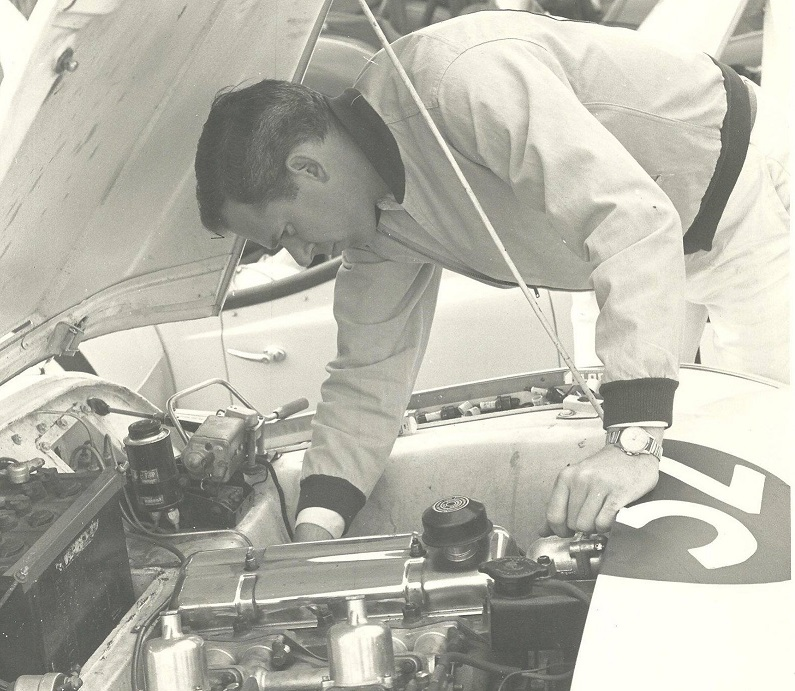 Kas checking the plugs in his 1958 TR-3, Pomona 1958